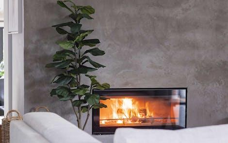 Faux fiddle leaf fig by wood burner
