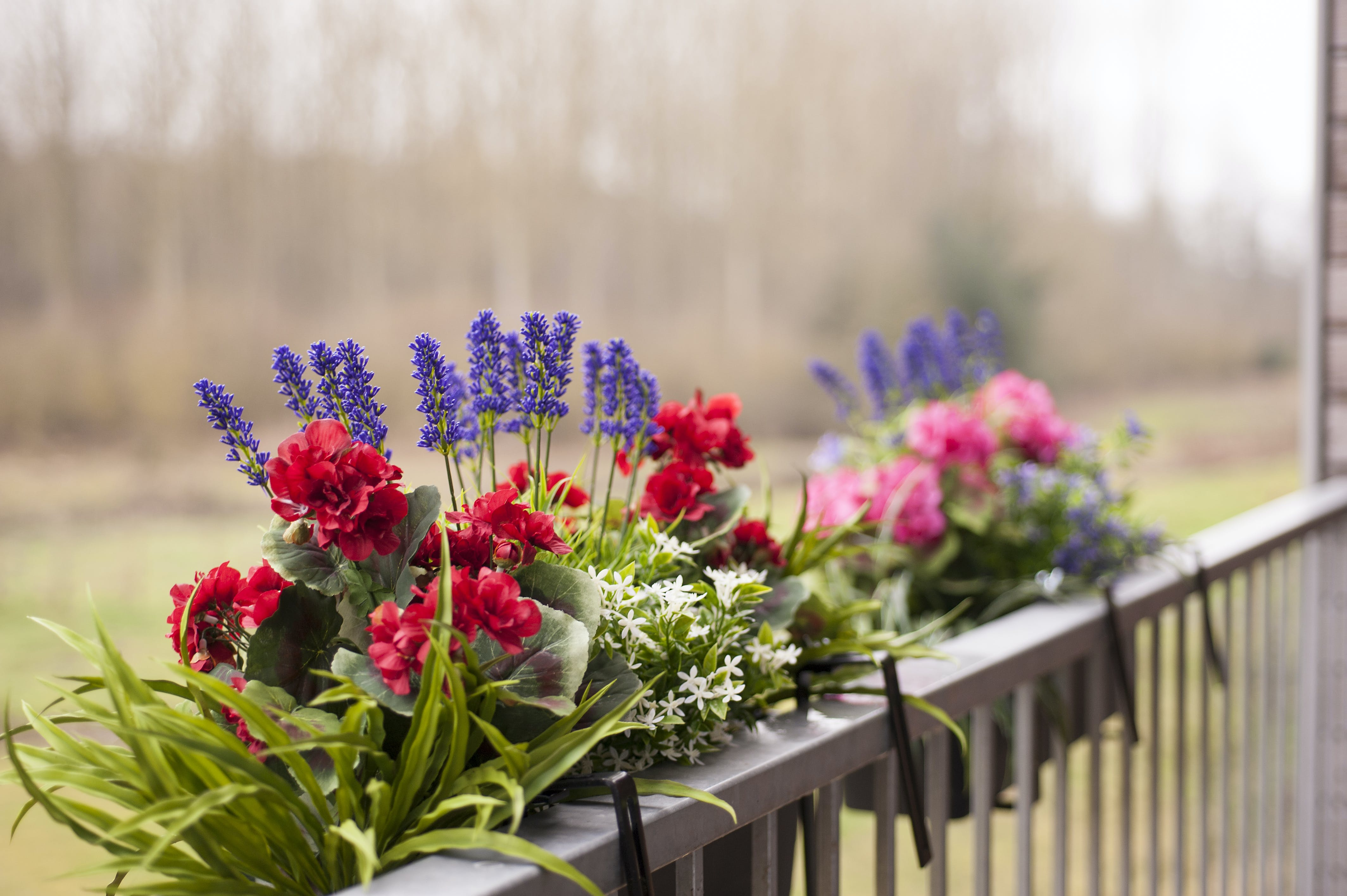 artificial window boxes with faux flowers and greenery