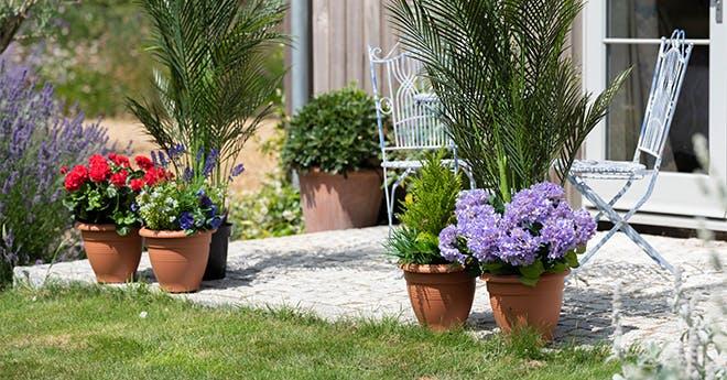 artificial outdoor patio planters on patio