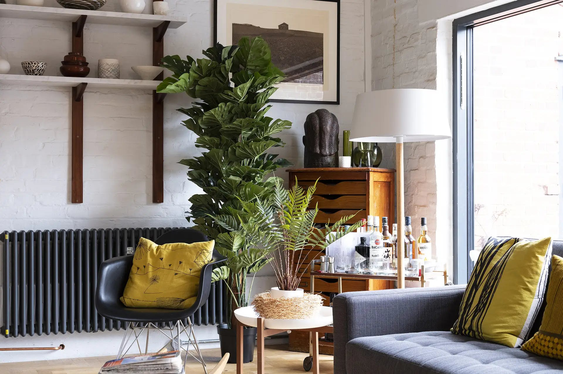 Artificial large cheese plant in cool living room