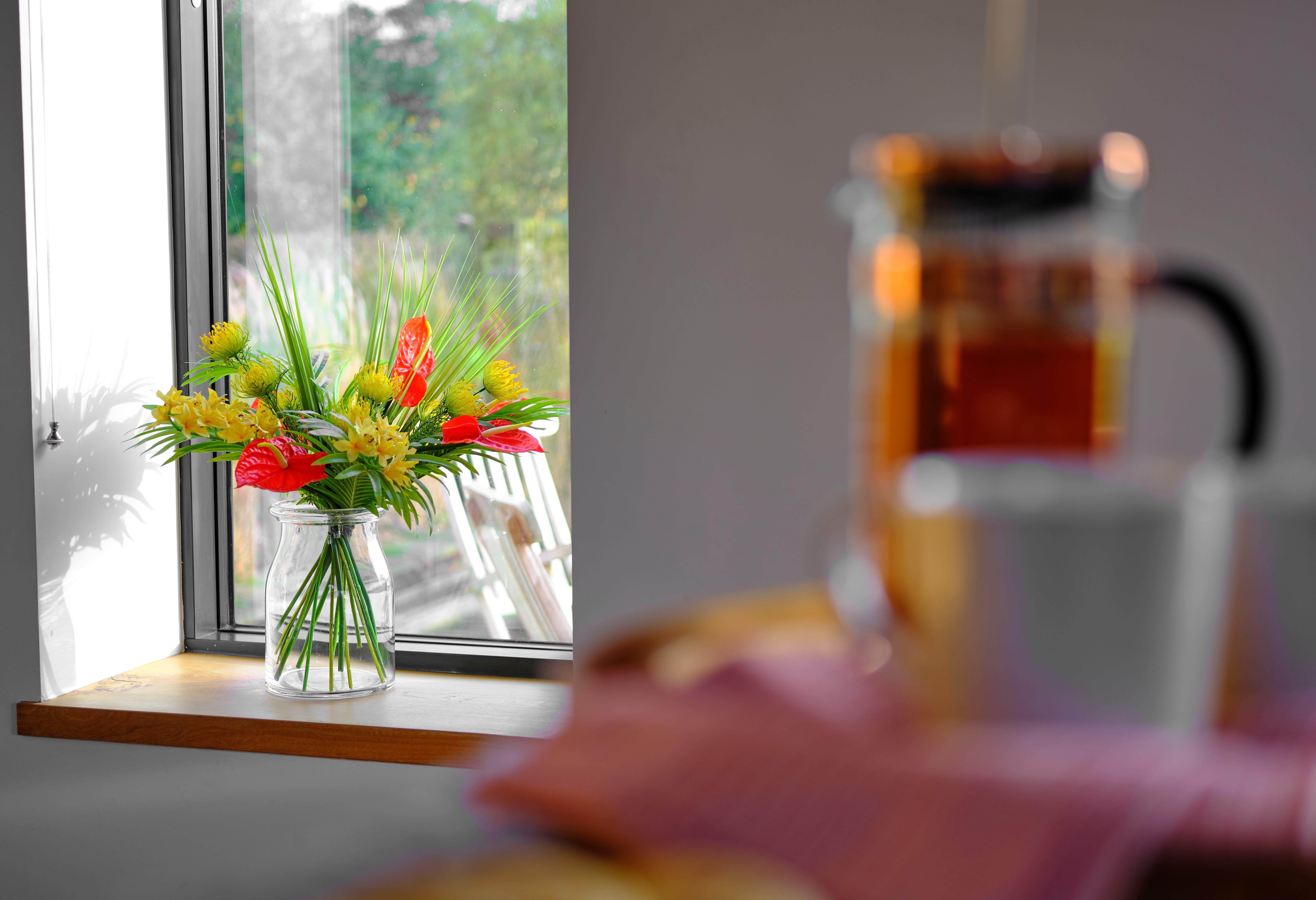 Artificial bahama mama bouquet on window sill
