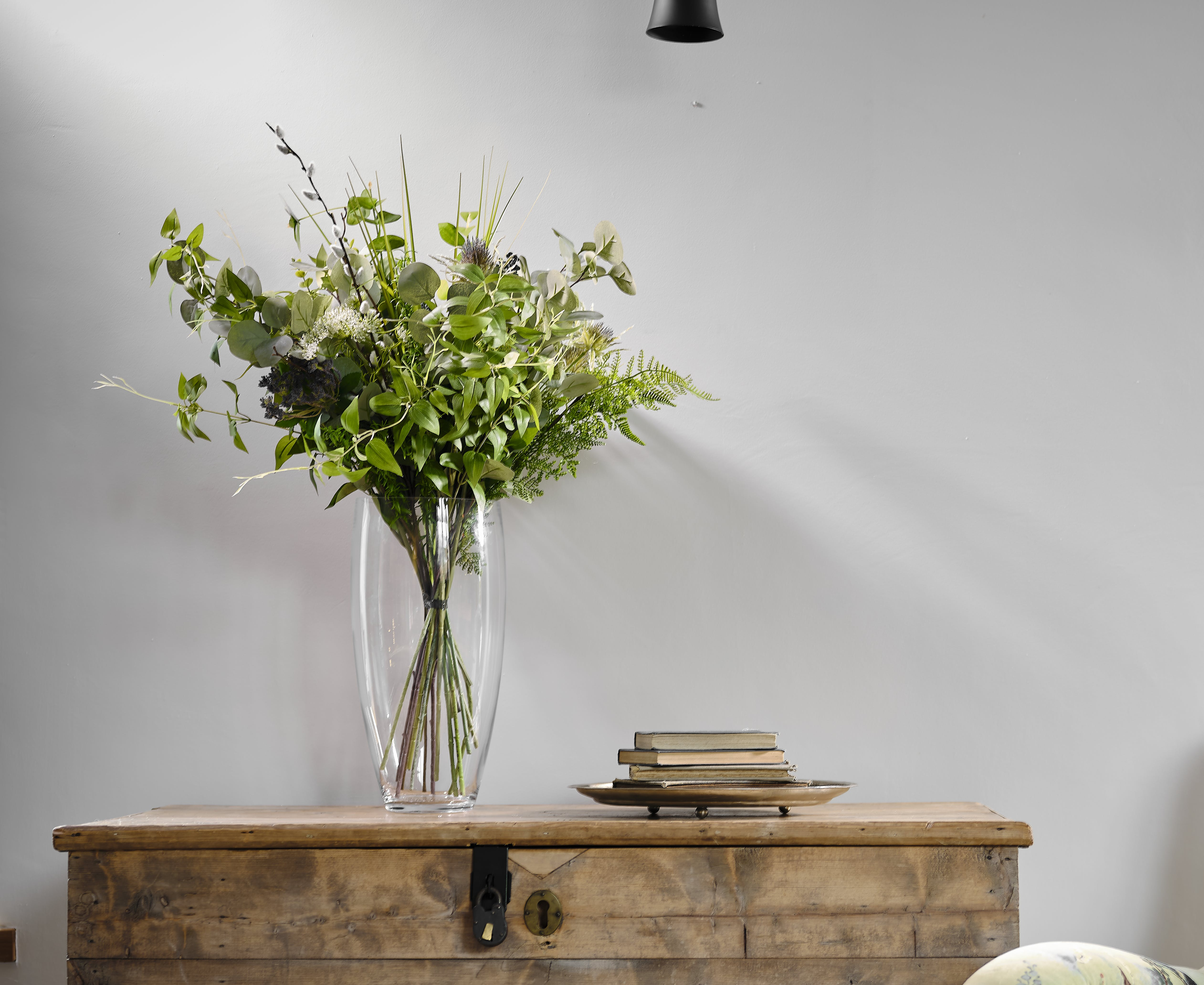 Fauxliage (foliage) artificial bouquet on chest table