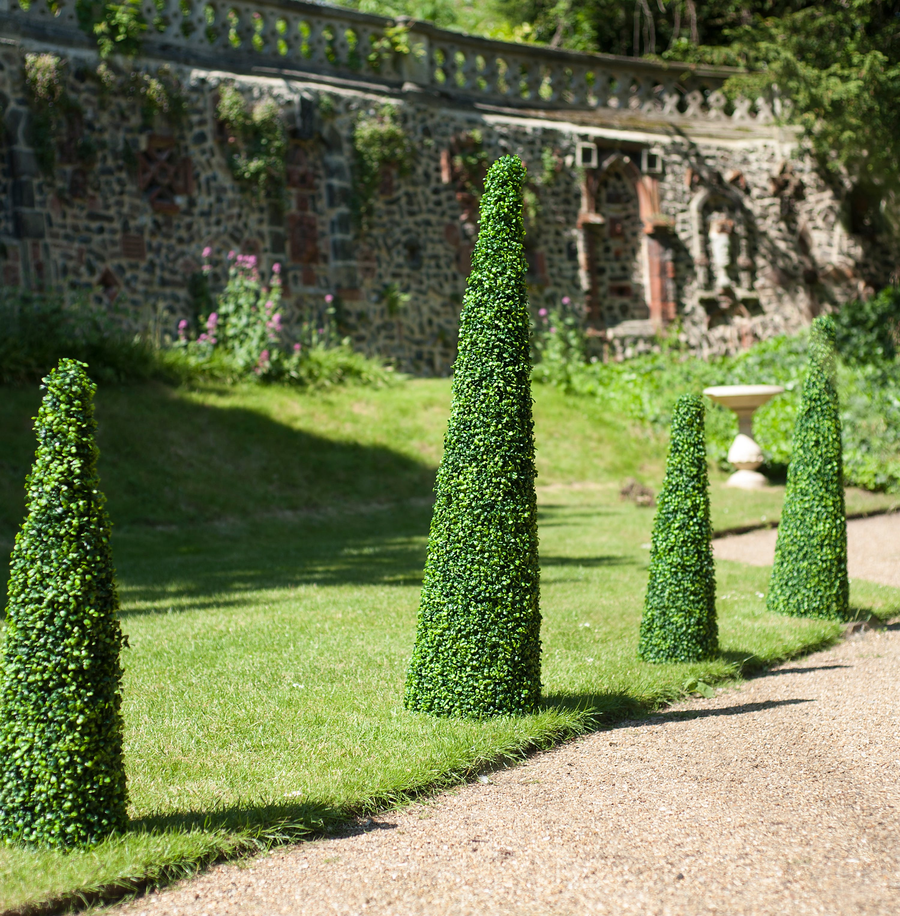 Artificial 120cm and 150cm boxwood cone in a row