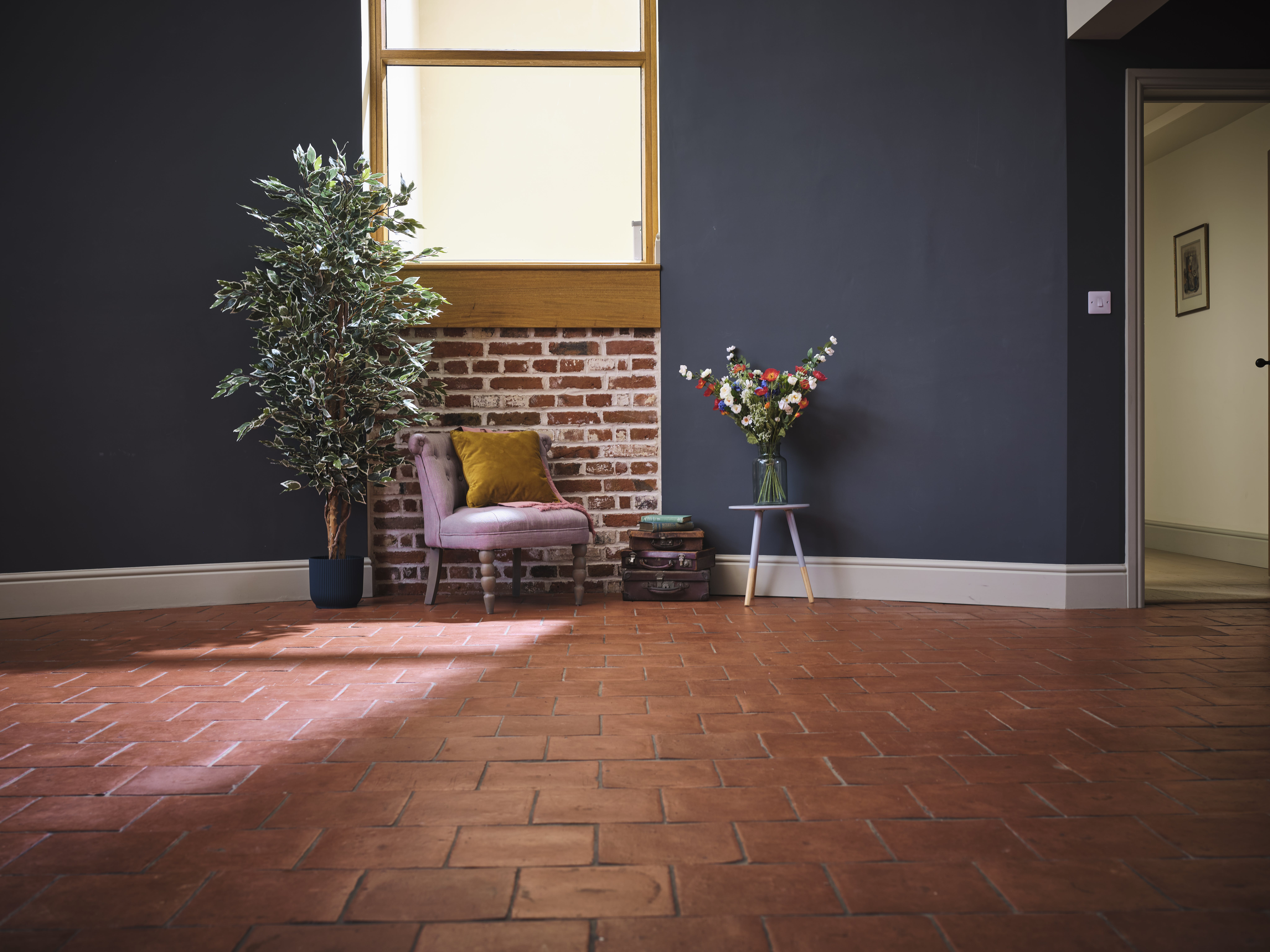artificial variegated ficus tree next to armchair 180cm