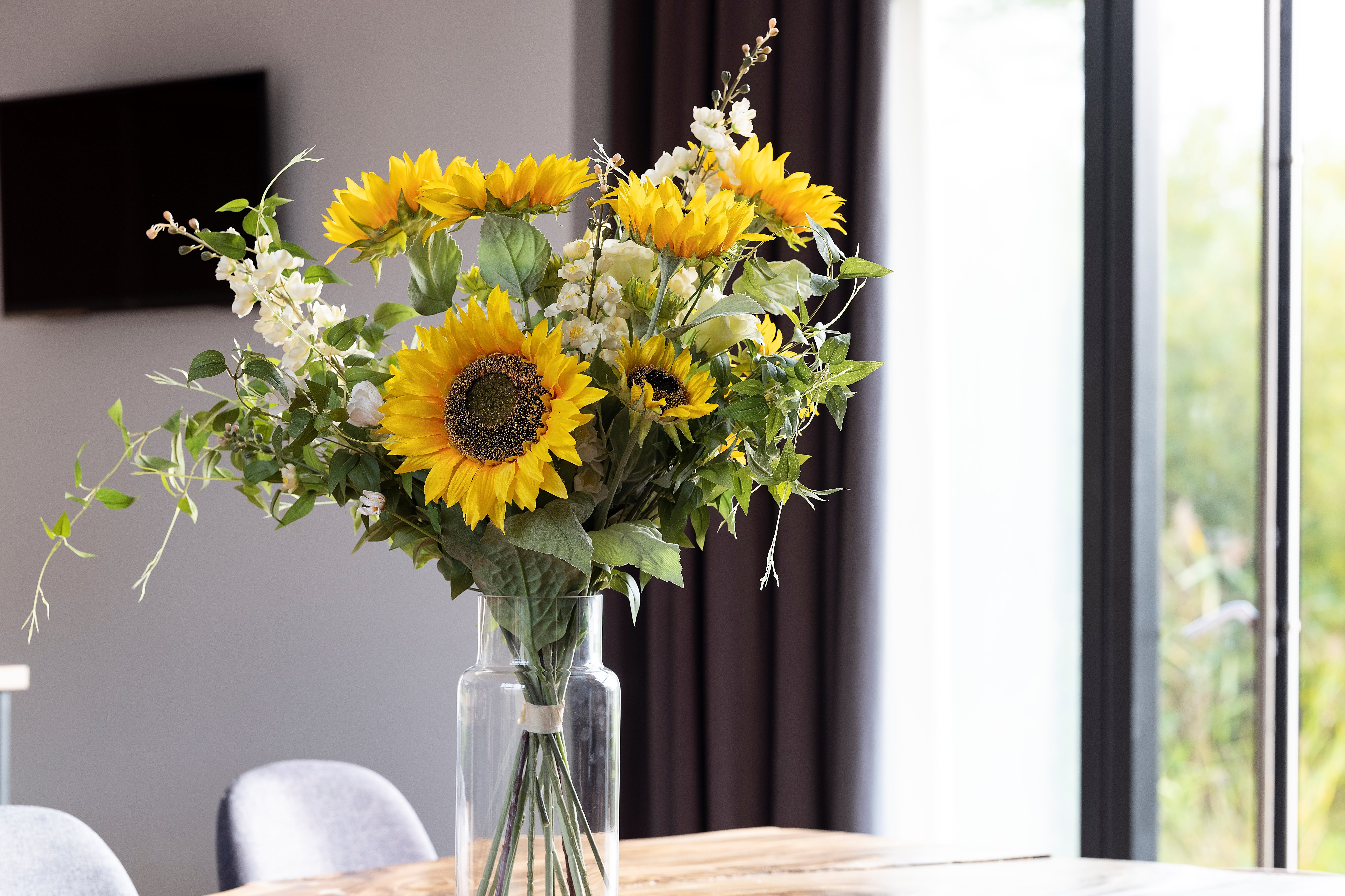 Summer artificial lazy days bouquet of flowers on table