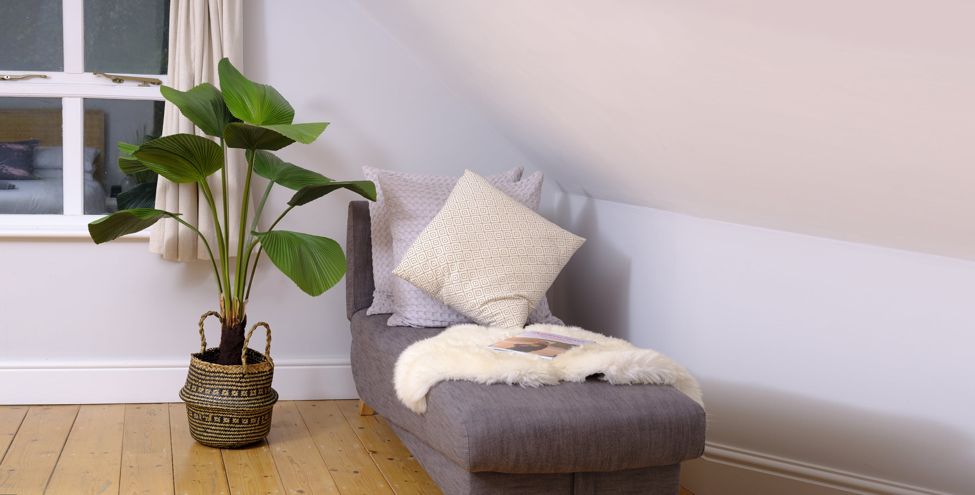 Artificial licuala palm near lounge chair