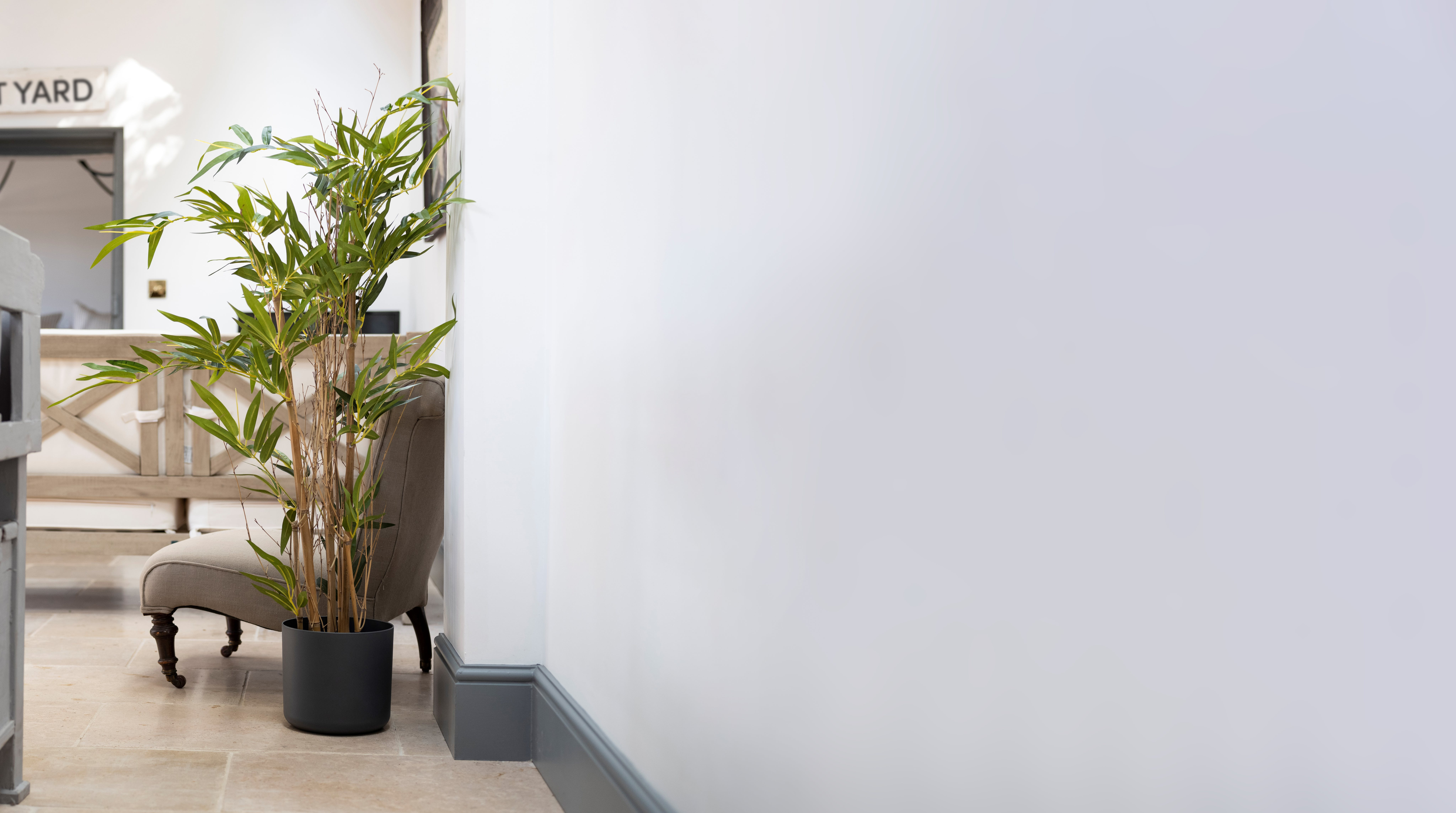 Artificial natural bamboo tree in scandi living room