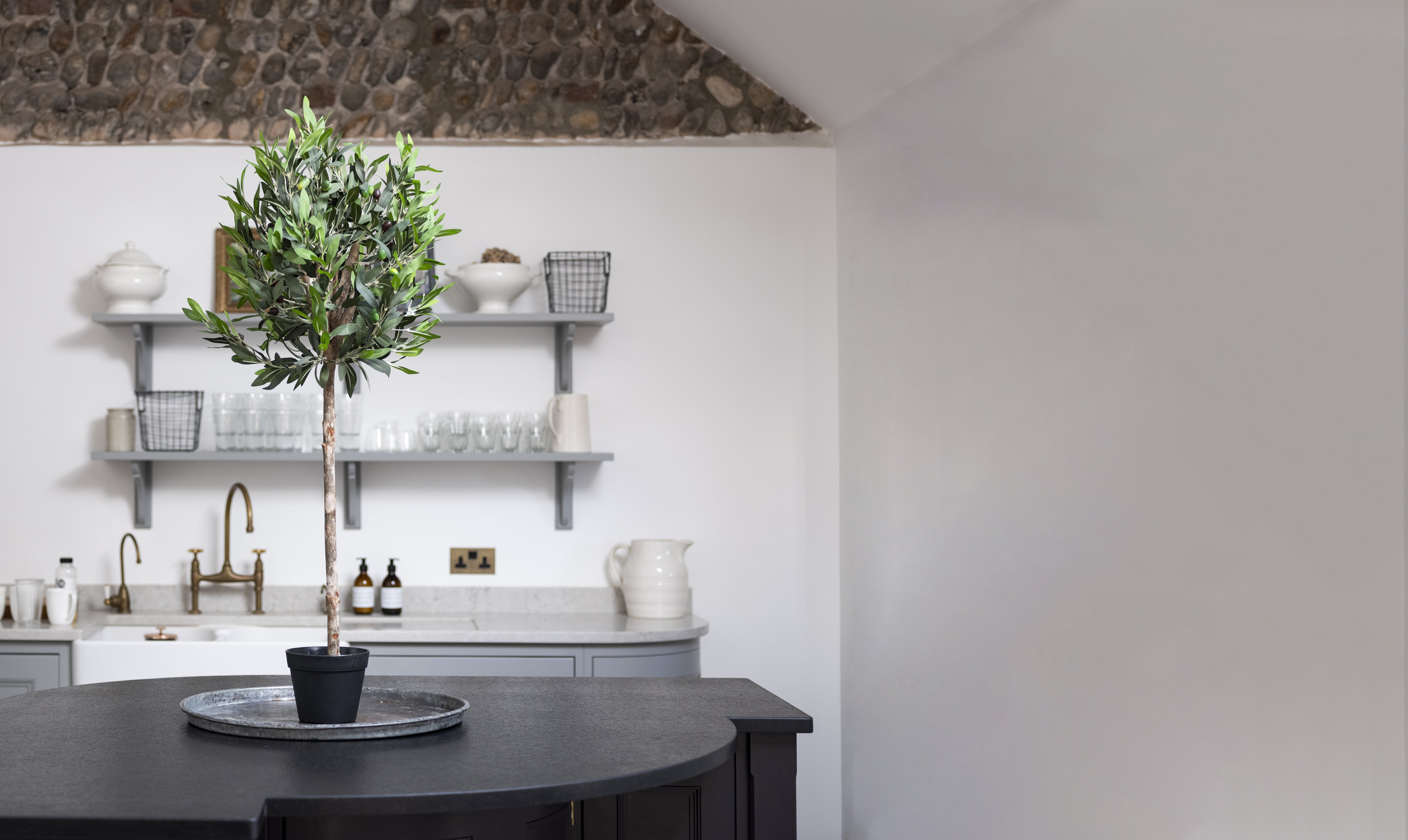 artificial olive ball tree on kitchen counter