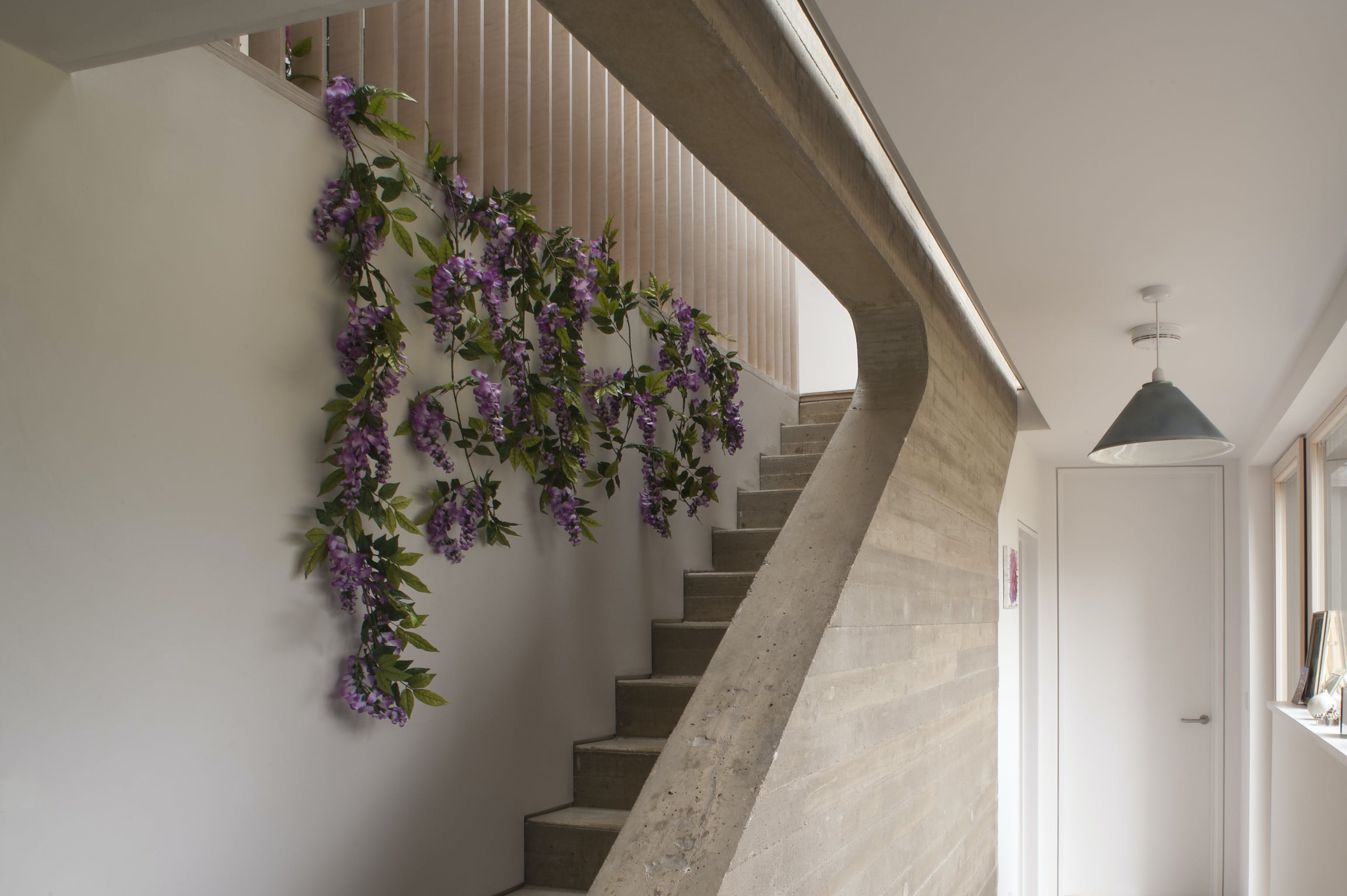 Artificial purple wisteria garland on staircase